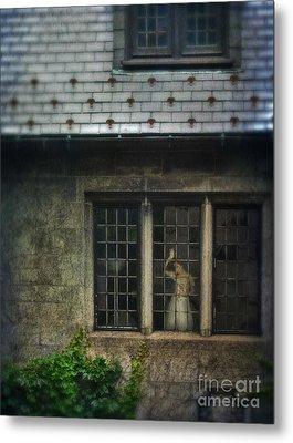 Lady By Window Of Tudor Mansion Metal Print by Jill Battaglia