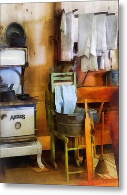 Laundry Drying In Kitchen Metal Print by Susan Savad