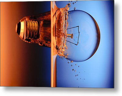 Light Bulb Shot Into Water Metal Print by Setsiri Silapasuwanchai