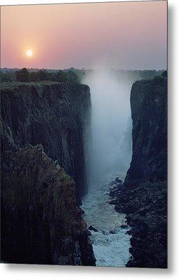 Looking Along Victoria Falls At Dusk Metal Print by Axiom Photographic