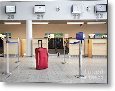 Luggage At An Airline Check-in Counter Metal Print by Jaak Nilson