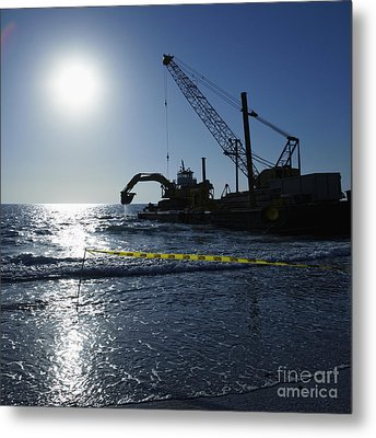 Machinery Cleaning Up A Pier Metal Print by Skip Nall