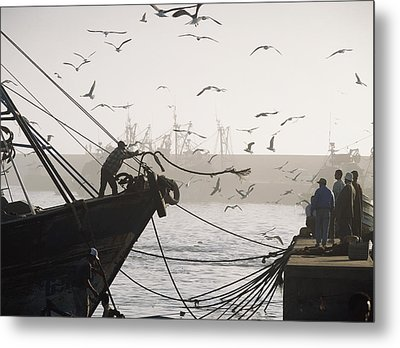 Man Throwing Rope To People On Dockside Metal Print by Axiom Photographic