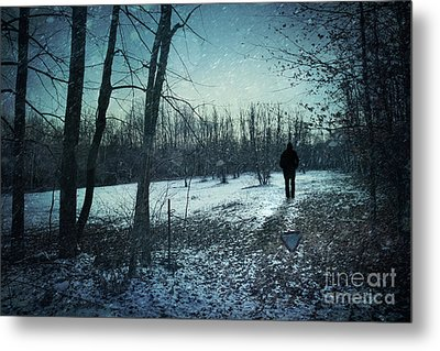 Man Walking In Snow At Winter Twilight Metal Print by Sandra Cunningham