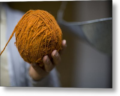 Mans Hand Holds Ball Of Orange Wool Metal Print by David Evans