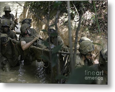 Marines Trudge Through The Mud Metal Print by Stocktrek Images