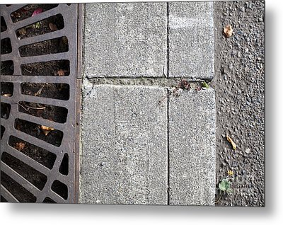 Metal Grate On Sidewalk Metal Print by Paul Edmondson