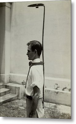 Model Wears A Slave Bell Rack, A Used Metal Print by Everett