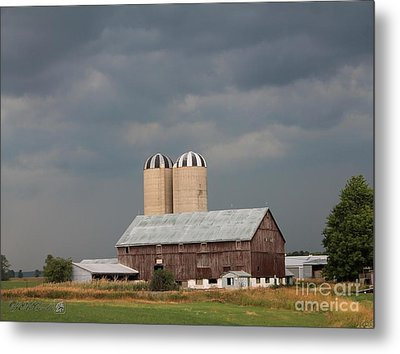 Ominous Clouds Over The Barn Metal Print by J McCombie