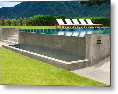 Outdoor Swimming Pool Metal Print by Atiketta Sangasaeng