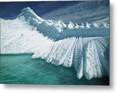 Overturned Iceberg With Eroded Edges Metal Print by Colin Monteath