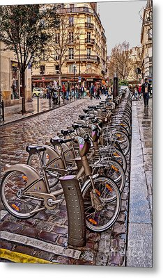 Paris Wheels For Rent Metal Print by Bob and Nancy Kendrick