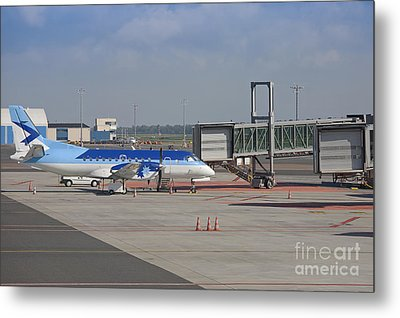 Parked Airplane At An Airport Gate Metal Print by Jaak Nilson
