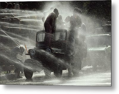 People Are Sprayed At The Water Metal Print by James L. Stanfield