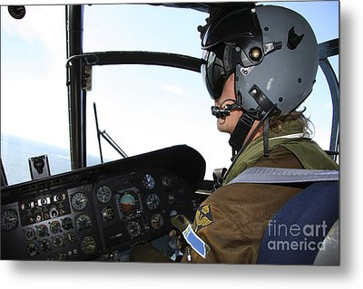 Pilot In The Cockpit Of A Ch-46 Sea Metal Print by Daniel Karlsson