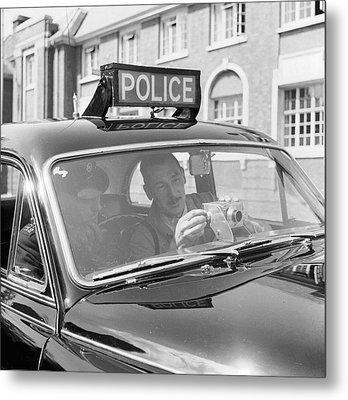 Police Camera Action Metal Print by Ken Harding