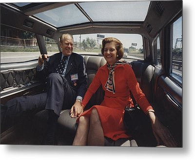 President And Betty Ford Hold Hands Metal Print by Everett