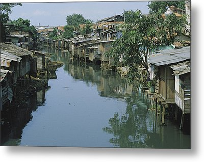 Ramshackle Houses Line A Canal Metal Print by Tim Laman