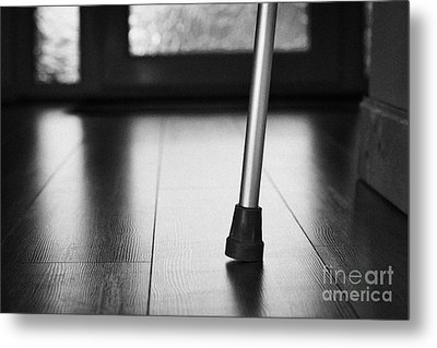 Single Crutch Leg Leaning Against A Wall In A House In The Uk Metal Print by Joe Fox