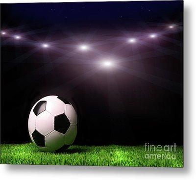 Soccer Ball On Grass Against Black Metal Print by Sandra Cunningham