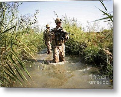Soldiers Patrol Through An Irrigation Metal Print by Stocktrek Images
