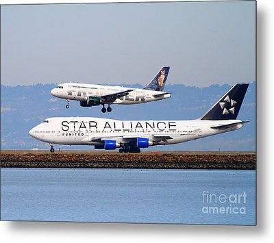 Star Alliance Airlines And Frontier Airlines Jet Airplanes At San Francisco International Airport Metal Print by Wingsdomain Art and Photography