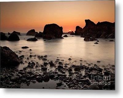 Sunset On A Rock Metal Print by Keith Kapple