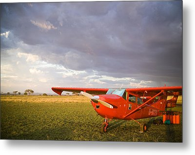 The Cessna Makes A Pit Stop To Refuel Metal Print by Michael Fay