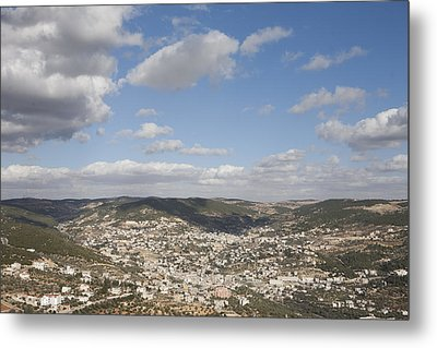 The Jordanian Countryside And The Town Metal Print by Taylor S. Kennedy