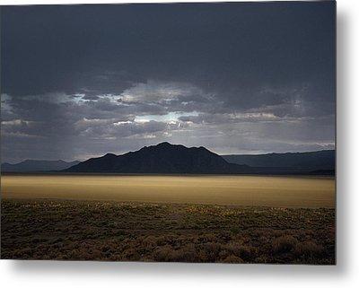 The Setting Sun Permeates Rain Clouds Metal Print by James P. Blair