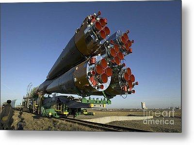 The Soyuz Rocket Is Rolled Metal Print by Stocktrek Images