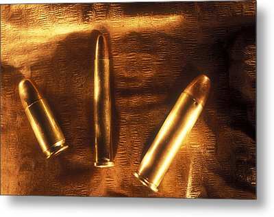 Three Golden 38 Calibre Bullets Metal Print by Lyle Leduc