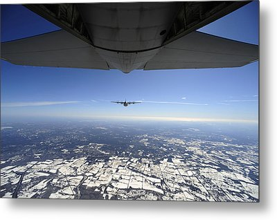 Two Ec-130j Commando Solo Aircraft Fly Metal Print by Stocktrek Images