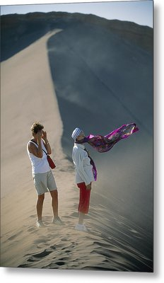 Two Tourist Are Transfixed Metal Print by Joel Sartore