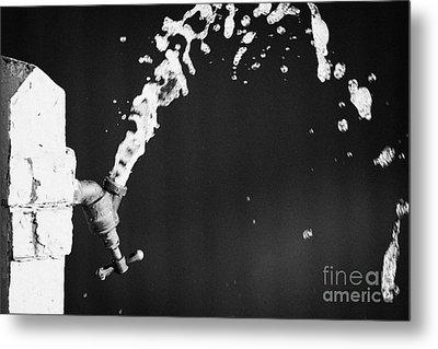 Upside Down Faucet Spraying Water Metal Print by Joe Fox