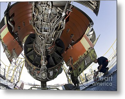 U.s. Air Force Technician Hydraulically Metal Print by Stocktrek Images