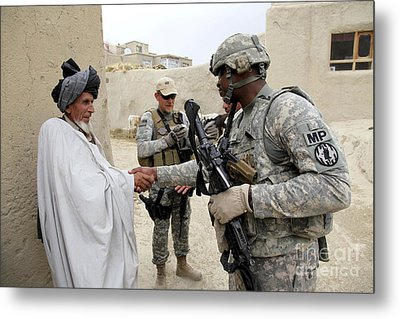 U.s. Army Soldier Shakes Hands With An Metal Print by Stocktrek Images
