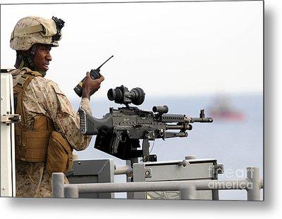 U.s. Marine Talks On A Radio While Metal Print by Stocktrek Images