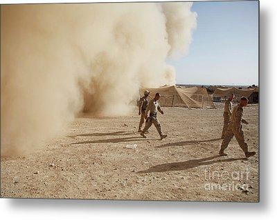 U.s. Marines Walk Away From A Dust Metal Print by Stocktrek Images
