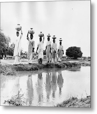 Water Carriers Metal Print by Three Lions