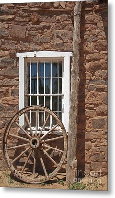 Window In Stone Building With Wagon Wheel Metal Print by Thom Gourley/Flatbread Images, LLC