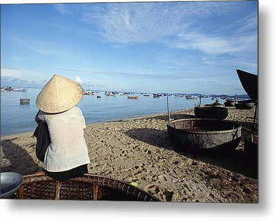 Woman In Conical Hat Sitting On Boat On Metal Print by Axiom Photographic