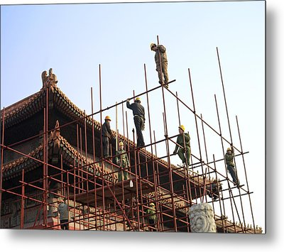 Workers Climb Scaffolding On The Palace Metal Print by Justin Guariglia