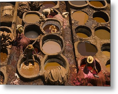 Workers In The Tanneries Of Fez Soak Metal Print by Annie Griffiths