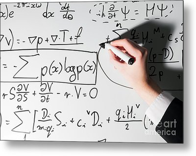 Man Writing Complex Math Formulas On Whiteboard. Mathematics And Science Metal Print by Michal Bednarek