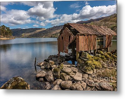 Rusty Boathouse Metal Print by Adrian Evans