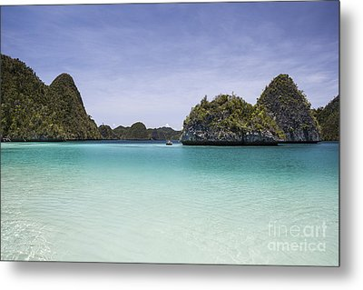 Rugged Limestone Islands Surround Metal Print by Ethan Daniels