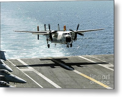 A C-2a Greyhound Prepares To Land Metal Print by Stocktrek Images