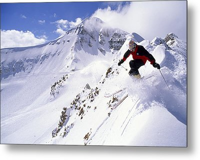 A Downhill Skier Launching Metal Print by Gordon Wiltsie
