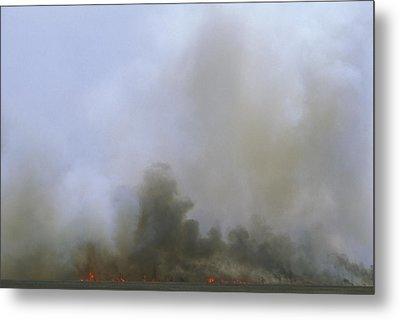 A Fire Burns In The Marsh On Ocracoke Metal Print by Stephen Alvarez